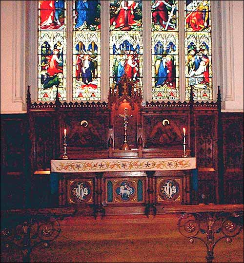 Photograph of the altar showing highlighted detail together with the East window