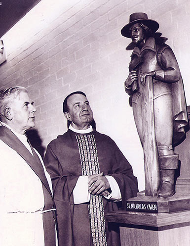 Photograph showing Father Donald Jenkinson and Mgr Frank Diamond admiring the new carved wooden figure of the martyr St Nicholas Owen