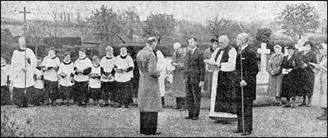 Further view of the consecration of burial ground in the new cemetery showing the church choir in the background