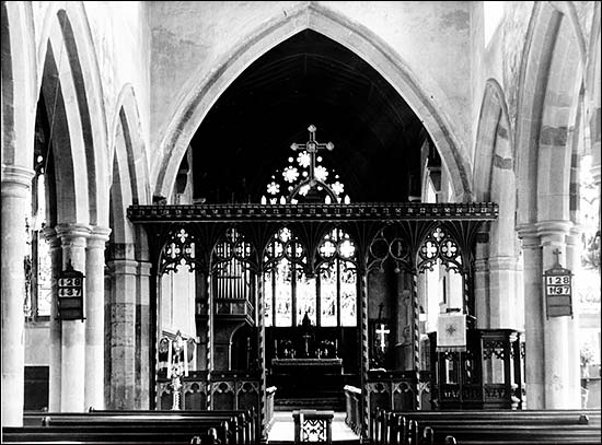 Photograph showing interior of church before 1969 restoration showing the rood screen