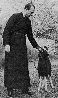 Photograph of Rev Derek Hole with Fred the goat
