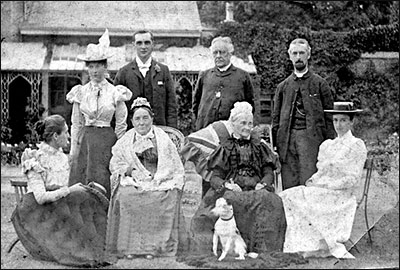 Reverend Newman (standing, third from left) pictured with his family in his later years.