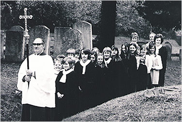 Photograph of the choir in 1975 processing through the churchyard