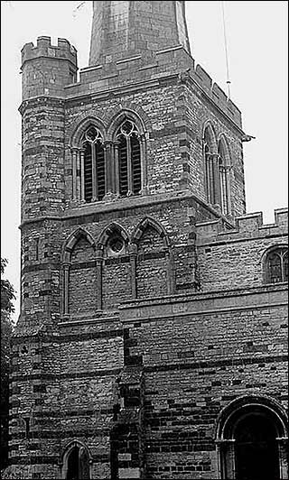 Photograph showing the south side of the tower with the belfry door and south door