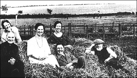 Mr & Mrs Talbutt with some of their family relaxing in their fields on The Wold c1925