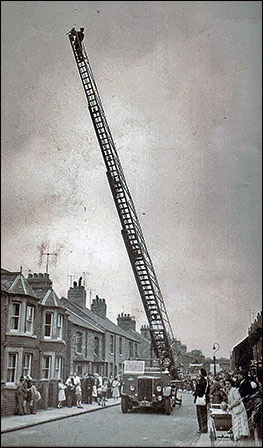 Gerald Baish on a turntable ladder in Alexandra Street