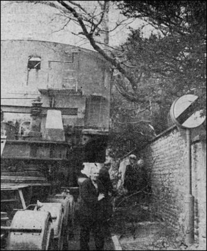 Photograph of a lorry's load entangled in an overhanging tree.