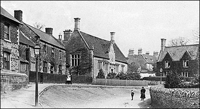 Photograph of Jacobean School and School House with Rectory in the background taken in 1905