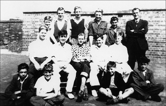 A group of boys with Mr Wetherall in the playground of Burton Latimer Council Junior School in about 1952