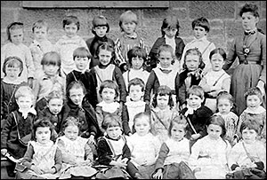 Photograph of Church School Infants with their teacher, early 1900