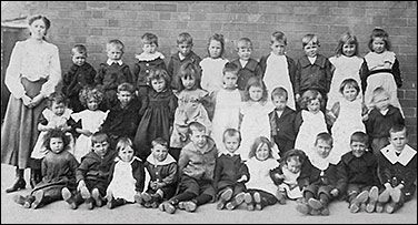 Photograph of Council School teacher with young pupils, early 1900