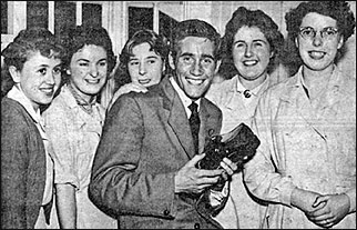 Photograph of Jim Dale, local pop and filmstar, in 1958 with workers