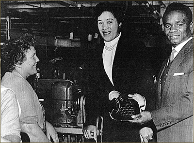 "Photograph showing Hogan ""Kid"" Bassey visiting Coles Boot Co in the late 1950s meeting a 'sample hand', Marjorie Evans"