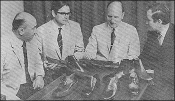 Mr Ted Reed, Mr John Matthews, Mr Angus Westley and Mr Walter Cornell examining some of the shoes produced