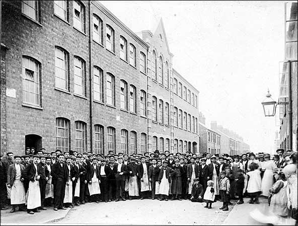 Workers pictured outside the factory