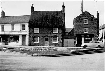 Thatched cottage at The Cross 1960s, when the war memorial had been removed