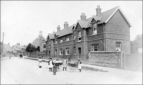 Photograph taken in 1905 showing the Cottage Homes with the stone gable-end of 159 High Street shown to the left of the block