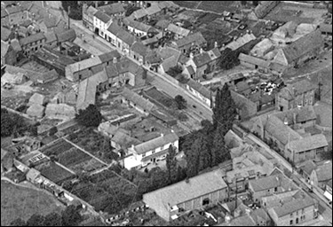 Aerila view of the central area of the High Street, taken in 1923.  The sachool, the cinema, The Poplars, and Denton's Farm are all clearly distinguishable