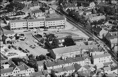 An aerial view of the central area in 1971.  The cinema is clearly visible, but the new Churchill Way development has replaced the old farm, and the gardens of The Poplars are now a car park.
