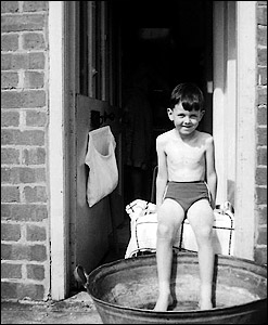 Cooling off on a hot day outside Millie West's front door 1963