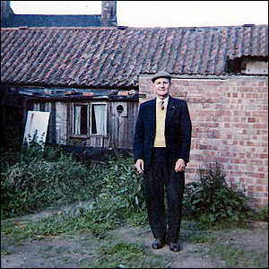 My dad at rear of Colin Plowman's barbers c.1966
