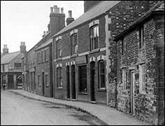 The row of houses and shops on the High Street between Bakehouse Lane and Church Street, before the development of the Co-op
