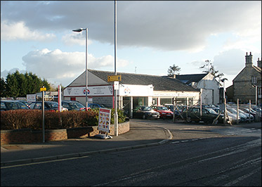 The car sales business which still survives ofn the site of the former businesses of Mason's Garage and Regency Cars