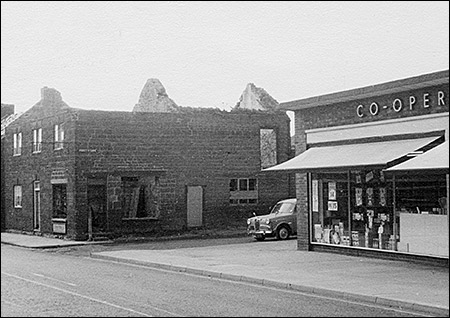 The demolition of the top end of the High Causeway in 1969.  Benford's barber's shop stood opposite the Co-op store