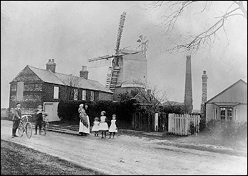 The north windmillin Burton Latimer in about 1906.  Hodson family in the foreground