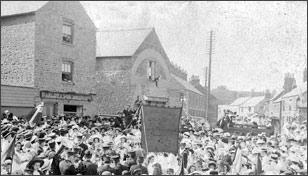 A rally in the early 1900s near the Gas Company offices centre of picture)
