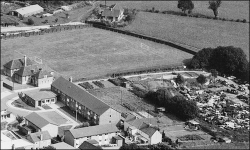 Now a scrapyard, with Latimer Close, Burton House and the school playing field.