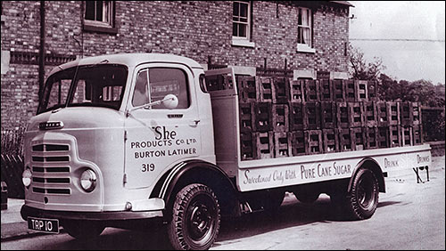 Photograph taken in 1964 of lorry in Meeting Lane with a full load of She Drinks.