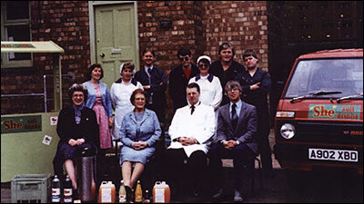 Photograph of the She Products Family and Staff taken in 1986.