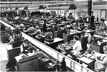 Photograph of operatives in the Closing Room stitching the uppers together