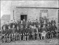 Workers outside the office of Lloyds Ironstone Company in Polwell Lane
