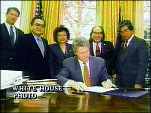 President Clinton signs the Congressional Resolution apologising to the people of Hawaii for the events of 1893