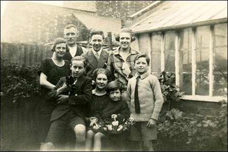 Annie Potter with her family and two of the London children - 1927