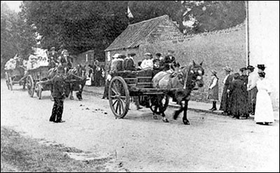 A Church procession with 'Bibs' Attfield in charge of the first farm wagon.