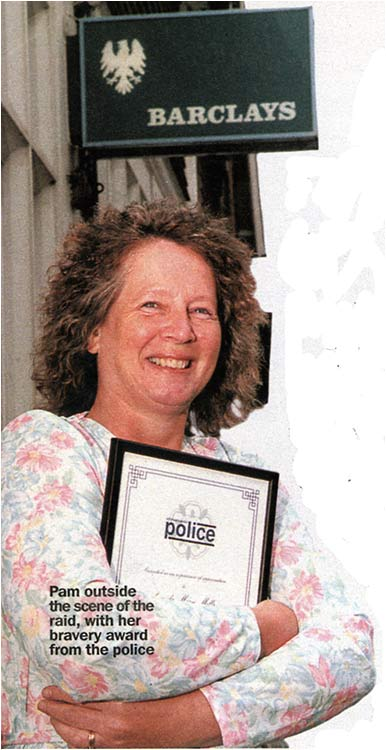 Photograph of Pam Mills with her bravery award from the police