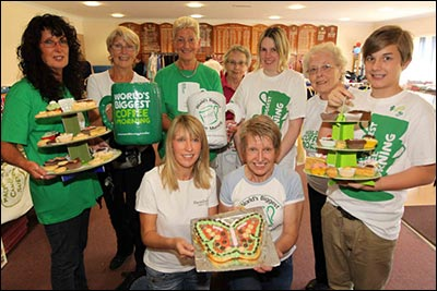 Iris Sharman pictured volunteering at a charity coffee morning in 2012