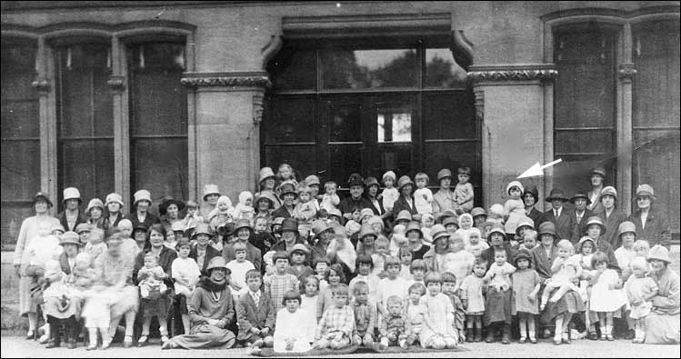 Photograph of mothers and children outside the Rectory.  Joan and her mother arrowed.