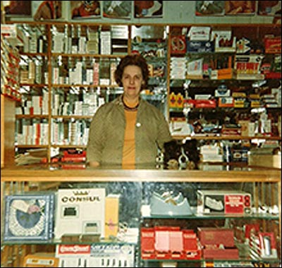 Photograph of Mrs June Smith at the newsagents shop