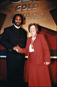 Pam Mills presented with the Gold Star by Lennox Lewis