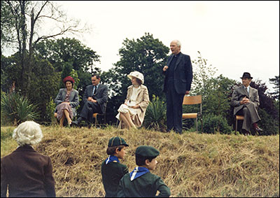 Photograph of Canon Pitt (Rector)  speakiing at a Church Garden Fete held at The Hall 8 July 1980.  L to R: Mrs Janet Harpur, Mr Richard Harpur, Lady George Scott, Rev Canon W E Pitt, Lord George Scott