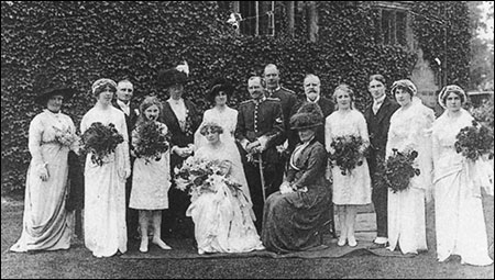 The de Crespigny wedding group showing Col de Crespigny standing behind the bridegroom and Mrs de Crespigny seated.  To the left of the bride is the younger daughter, Gwendoline, and third from the right is their only son, Arthur.
