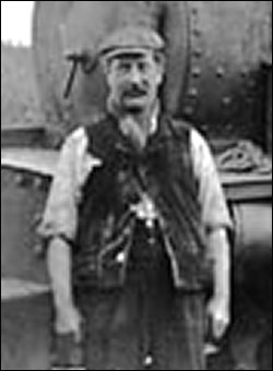 Photograph of Arthur W Hodson showing him as an engine driver employed by the Burton Ironstone Company living with his large family at Windmill Cottages