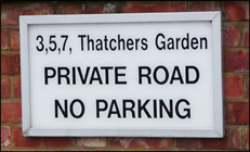 Sign to thatchers Garden