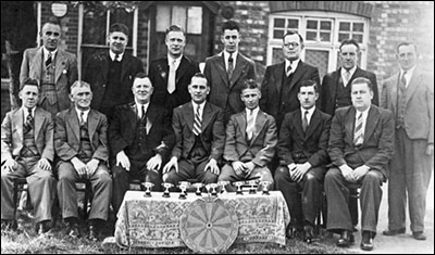 Photograph of the Darts Team taken in the 1950s.