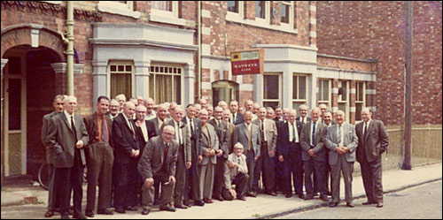 Photograph taken outside the Club in the mid 1970s showing the older members about to embark on an outing.