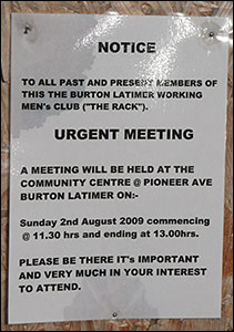 Photograph of a notice advertising an urgent meeting for members past and present.